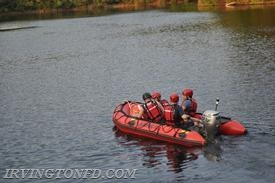 Elmsford firefighters testing the waters in the Irvington Reservoir.