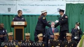 Firefighter Dennis Montaruli, Jr. receiving his certificate for FFI.  Photo credit: D. Montaruli, Sr.