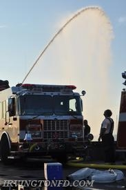 FF Will Baisley checking out the deck gun of E-177.  Photo credit: Lt. Dowd