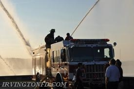 Firefighters using the deck gun on E-177.  Photo credit: Lt. Dowd