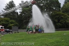 The Irvington football team taking the cold water in stride.
