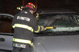 Photo credit: FF Paul Wool  Lt. Dan Billings cutting the windshield.