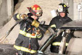 Photo credit: FF Paul Wool  Lt. David Dowd and Ex-Chief Jim Ruffler cutting the 'A' post of a vehicle.