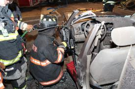 Photo credit: FF Paul Wool  FF D. Montaruli Jr. using a ram on the drivers side doorway.