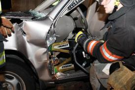 Photo credit: FF Paul Wool  FF D. Montaruli Jr. using the spreaders to roll the dashboard.