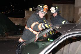 Photo credit: FF Paul Wool  Ex-Chief Jim Ruffler overseeing FF. Dennis Montaruli Jr. cutting the windshield.