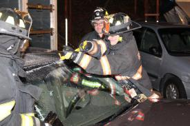 Photo credit: FF Paul Wool  FF Will Baisley overseeing FF Joe Kimmel cutting the windshield.