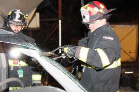Photo credit: FF Paul Wool  FF Kevin Gallagher overseeing Lt. Steve Mangiacotti cut the 'A' post.