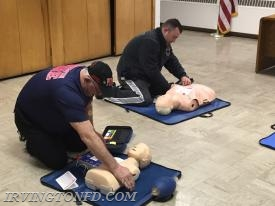 FF Hank Trama, 2nd Assistant Chief J. Trama practicing with the AED.  Photo courtesy of FF D. Montaruli, Sr.