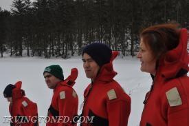 Lt. Dowd, Lt. Billings, FF Furuta & FF Feldman watching crews on the ice.