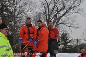 FF Cancro, Lt. Mangiacotti and FF Lambros tending to the safety line.