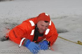 Chief J. Trama pulling himself out of the ice hole.