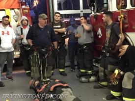 Instructor Dave showing members techniques for rescuing a downed firefighter with the tools we carry in our gear.