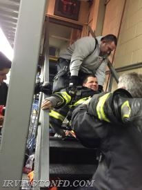 FF M. Trama pulling Ex-Chief Jim Ruffler up the stairs along with one of our instructors.
