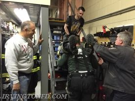 Members practicing lifting skills on a staircase.  Chief DePaoli looks on as FF D. Montaruli, Jr. and FF. P. Cancro pull the member to safety.  One of our instructors teaching the proper technique step by step.