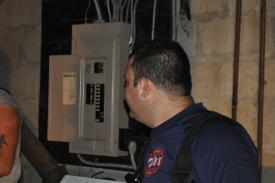 2nd Assistant Chief J. Trama showing members the electrical panel.