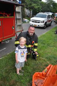 Ex-Chief and Safety Officer showing one of the children in the neighborhood (Zach) what's going on.