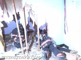Members of TL-78 practicing extricating themselves through a wall.