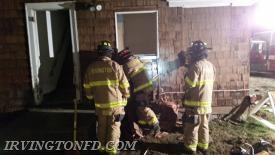 Irvington members breaching a wall from the outside.