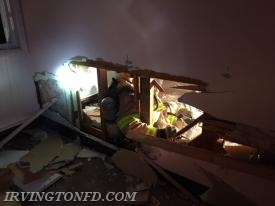 Irvington FD practicing extricating themselves through a wall.