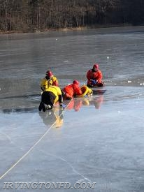 Irvington firefighters practicing their ice rescue skills.