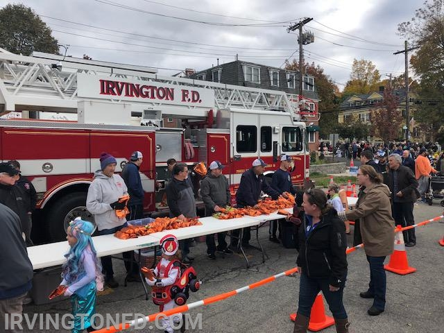 Members handing out candy to the kids after the parade.