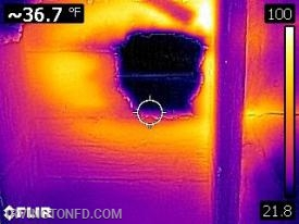A picture through our thermal imaging camera shows the hole through the deck as well as some moderate heat spots around the hole.
